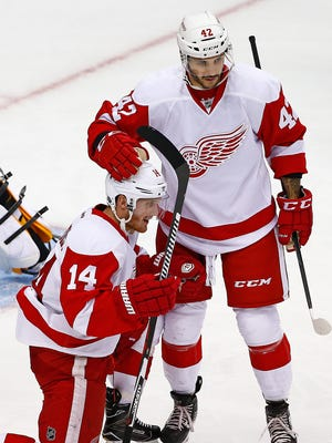 Detroit Red Wings forward Martin Frk, right, celebrates against the Pittsburgh Penguins on Wednesday, Oct. 5, 2016.