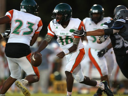 FAMU DRS' Adrelin Robinson scrambles out of the pocket against Maclay during their game at Maclay school on Friday, Oct. 20, 2017.