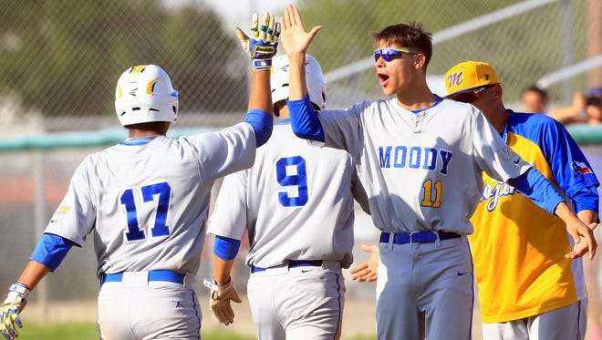 Moody's Andrew Hernandez (right) high-fives teammates after scoring against King on Friday, April 21, 2017, at Cabaniss Baseball Field in Corpus Christi.