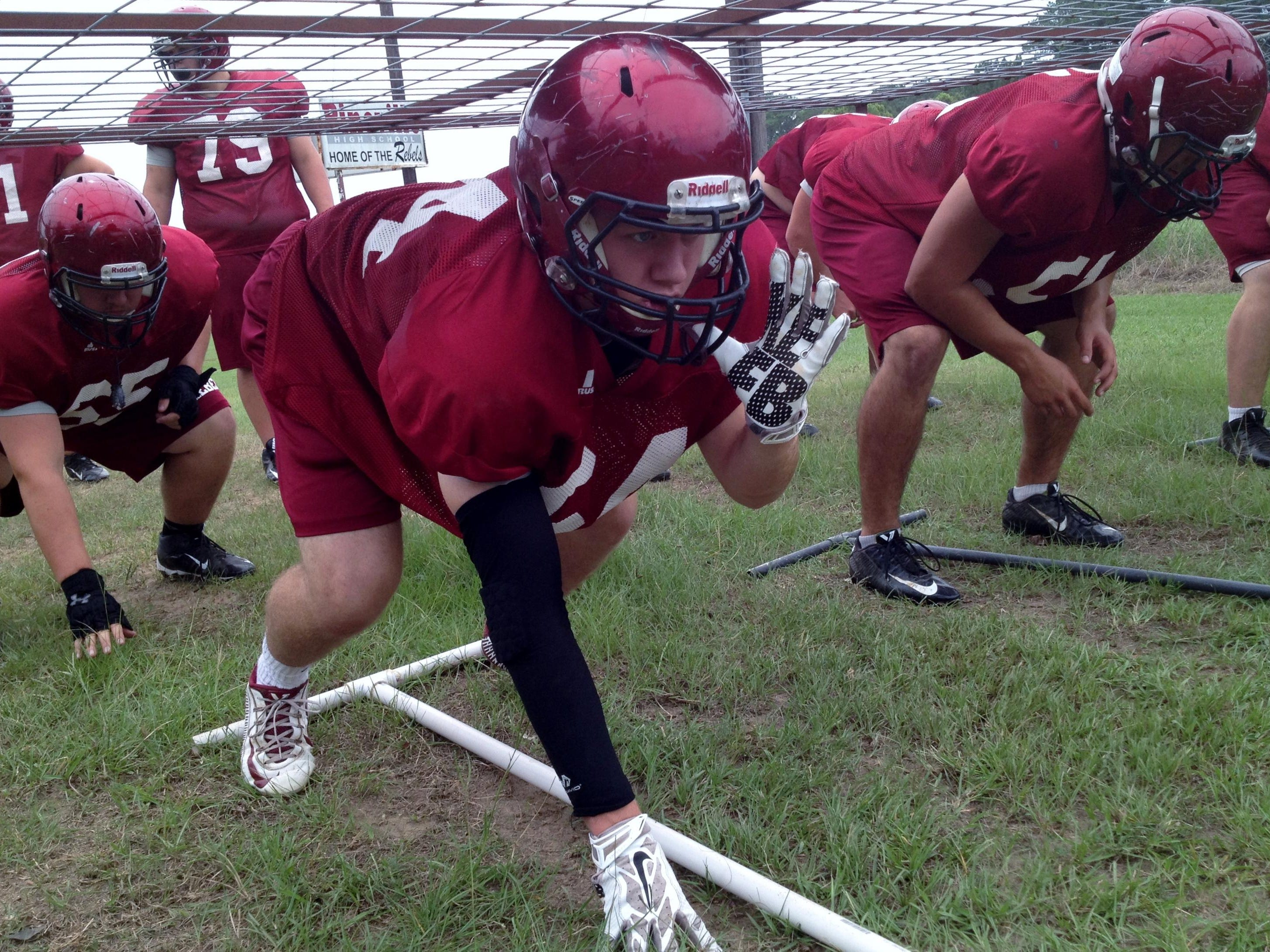 Pineville senior right tackle Harrison Nugent (64) prepares for a drill during practice Tuesday. The undersized Nugent is one of the top academic and most involved students at Pineville High School.