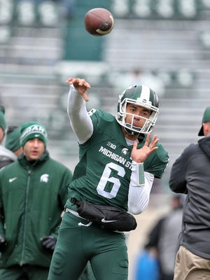 Michigan State Spartans quarterback Damion Terry (6) warms up prior to the game against the Ohio State Buckeyes at Spartan Stadium.