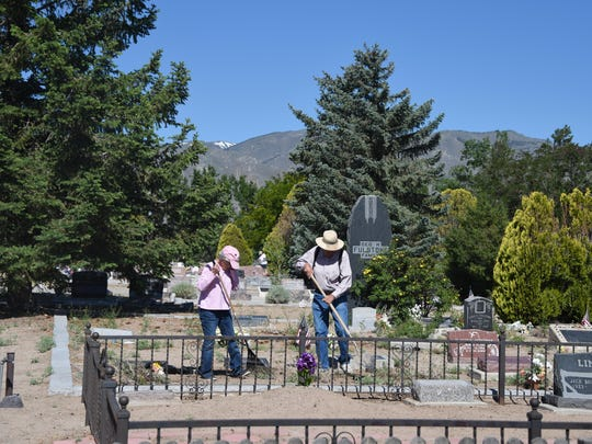 Jean Smith, left, and Lawrence Smith were part of the cleanup crew Saturday at Hillcrest Cemetery in Smith Valley.