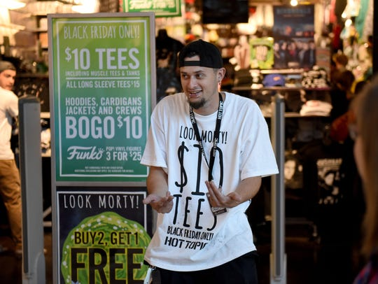Scotty Mason tries to lure shoppers into the Hot Topic