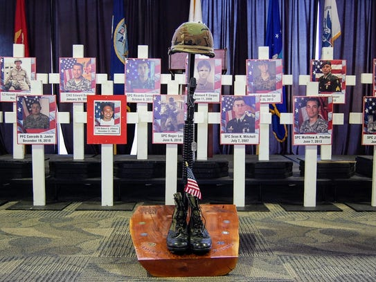 """Close to 80 people gathered at Hartnell College's Student Center on Tuesday for the opening of the """"Remembering Our Fallen"""" memorial, a traveling photographic display honoring nearly 5,000 soldiers who died in the global war on terrorism since Sept. 11, 2001."""