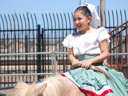 A child takes a ride at the 2018 Founder's Day in Salinas