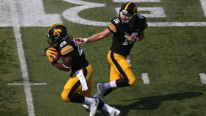 With any luck, quarterback C.J. Beathard, right, won't have to put in a full day vs. North Texas and running back LeShun Daniels Jr., left, might get to rest his injured right ankle.