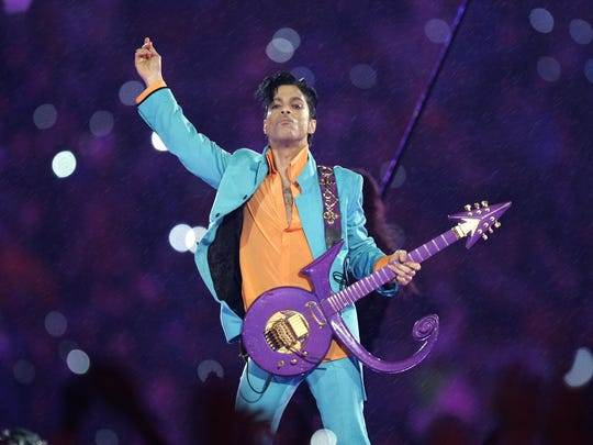 Prince performs during the halftime show at the 2007 Super Bowl XLI NFL football game at Dolphin Stadium in Miami. Prince died April 21 at the age of 57.