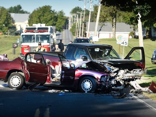 A South Lebanon Township police officer investigates Tuesday morning's fatal crash on Route 897 at the Iona Road split.
