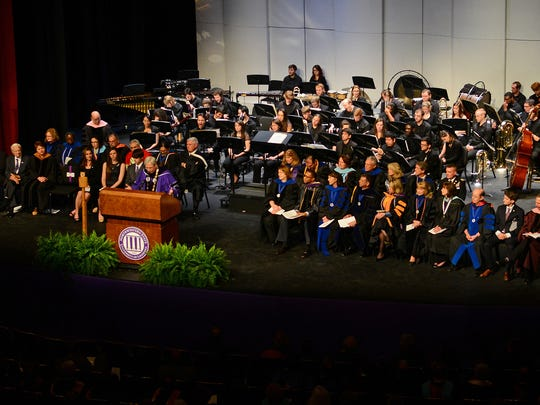 Deans, department heads, honored guests and dignitaries share the stage with Jim Henderson as he addresses faculty, staff, students and friends of Northwestern State University during Friday's investiture ceremony. Henderson's vision is to lead Northwestern State to becoming the premier southern regional university.