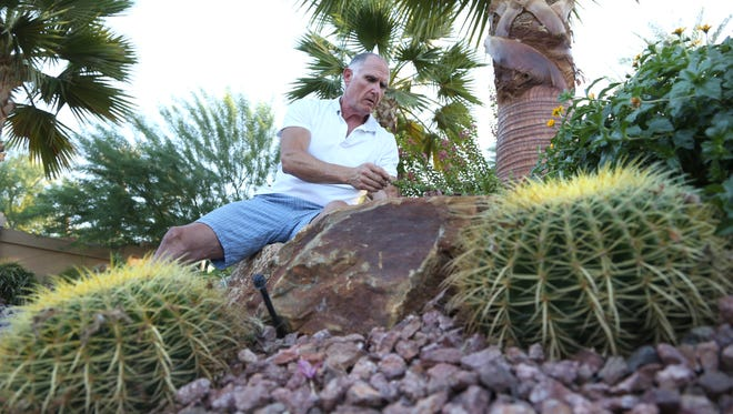 Palm Desert resident Randy Roberts explains the benefits of switching to a desert landscape in order to conserve water on Wednesday.