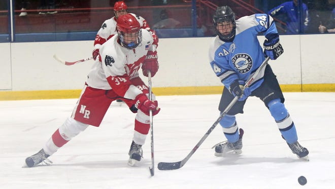 North Rockland's John Gormley (34) and Suffern's Harrison Gdanski (24) tries to gain control of the puck during boys hockey at Sport O Rama in Monsey Jan. 16,  2017.  North Rockland defeats Suffern 3-2.