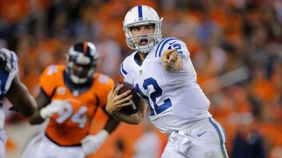 Colts quarterback Andrew Luck scrambles against the Broncos on Sept. 7 in Denver.