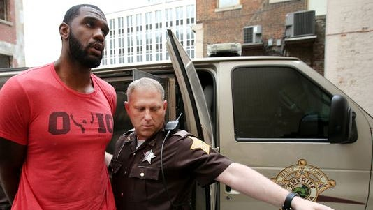 Greg Oden is escorted into the Marion County Community Corrections building on Thursday.