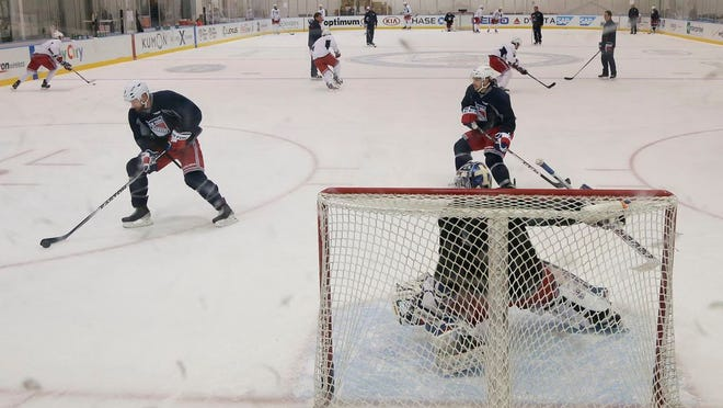 The New York Rangers run through drills at their practice facility, Monday, June 2, 2014, in Greenburgh.