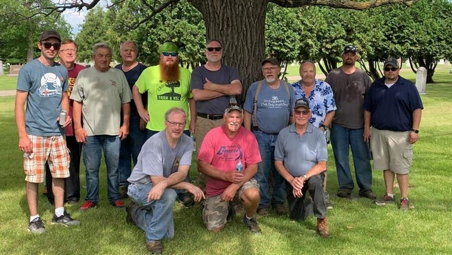 Some of the crew that helped in Oakdale Cemetery is pictured.