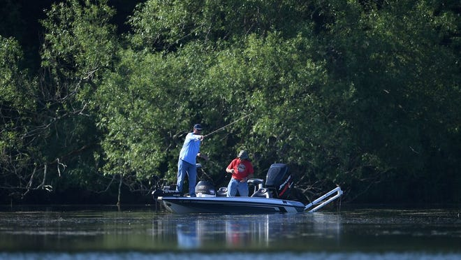 Fisherman work the waters near the head of Presque Isle Bay on June 5.