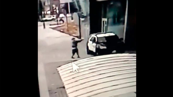 A screen grab from a security camera video released the Los Angeles County Sheriff's Department shows a gunman walking up to sheriff's deputies and opening fire without warning or provocation in Compton, Calif., on Saturday, Sept. 12, 2020. Officials say two Los Angeles County sheriff's deputies were shot in their patrol car at a Metro rail station in what appeared to be an ambush. The sheriff's department said the male and female deputies were shot in the head and had multiple gunshot wounds and were undergoing surgery. Deputies were searching for a suspect.