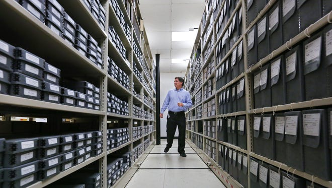 State Archivist Jim Corridan searches for materials stored in the Indiana State Archives facility at 6440 E. 30th St., Indianapolis on Thursday, Aug. 20, 2015. The facility stores more than 300 million pages of paper and 450 million images on film, mostly microfilm.
