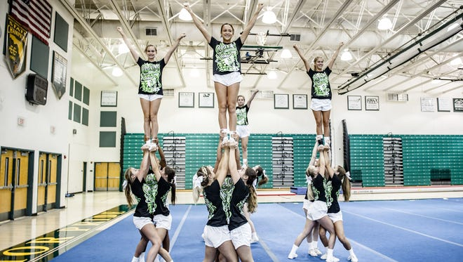 Florida high schools now recognize cheerleading as a sport and it progressed to competitions, increasing the required skill levels. Pictured, Jupiter High School varsity cheerleaders practice.