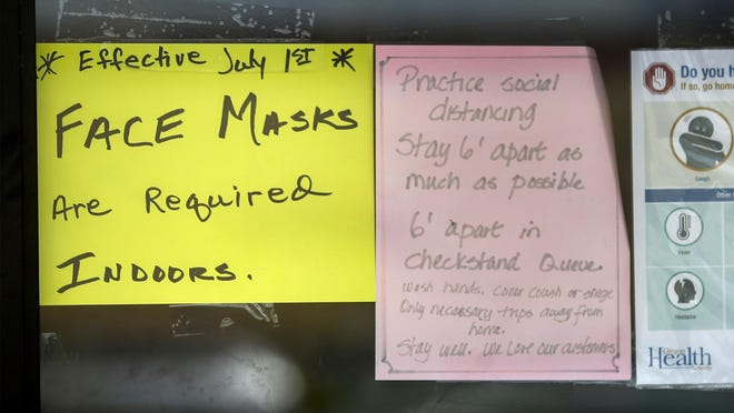 A sign on the door of Tru-Value Hardware on Willamette Street reminds customers of the statewide policy on mask-wearing indoors. [Andy Nelson/The Register-Guard] - registerguard.com