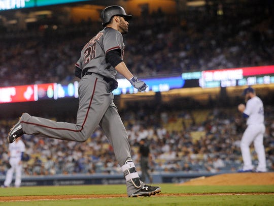 Diamondbacks right fielder J.D. Martinez (28) rounds the bases after hitting his third of four home runs in a game against the Dodgers on Sept. 4.