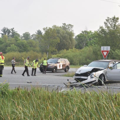 Investigators examine the scene of a fatal accident Monday morning at U.S. Highway 10 and Minnesota Boulevard.
