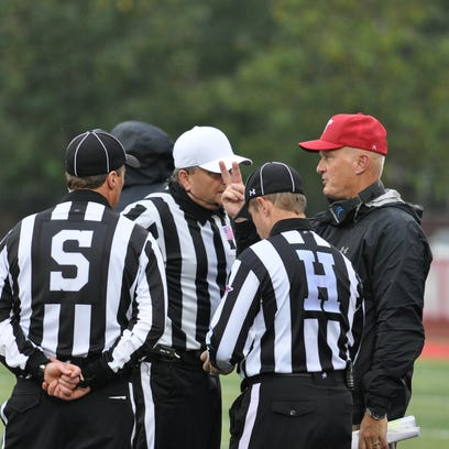 Coach Kirby Cannon discuss a call with officials in Austin Peay's Saturday, Oct. 3.