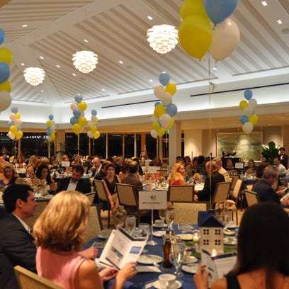 On Friday, November 20, the Hunger & Homeless Coalition of Collier County held it's annual fundraiser. The fundraiser was held at the Naples Beach Hotel.