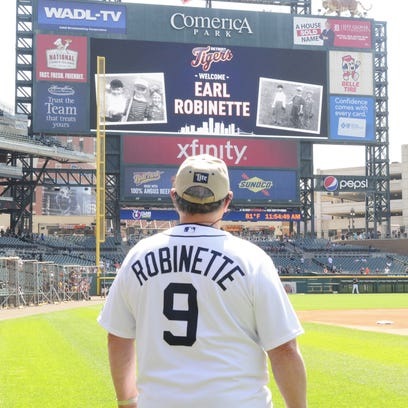 Earl Robinette of Fort Gratiot sits in the home dugout at Comerica Park after signing a one day contract with the ball club on May 25, 2016.