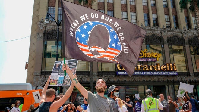 QAnon demonstrators protest on Hollywood Boulevard in Los Angeles, California, August 22, 2020. A 2019 bulletin from the FBI warned that conspiracy theory-driven extremists are a domestic terrorism threat.