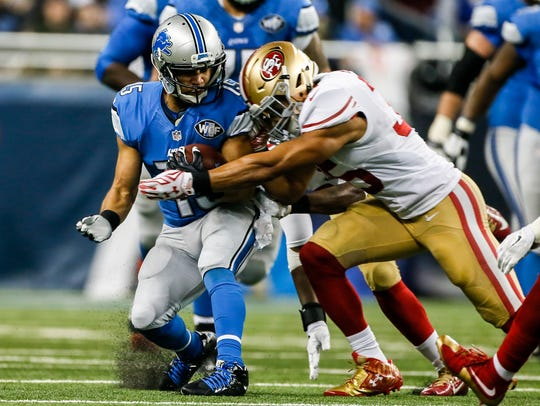 Detroit Lions WR Golden Tate runs for extra yards after