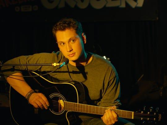 "Travis (Matt McGorry) is a musician in ""How He Fell in Love."""
