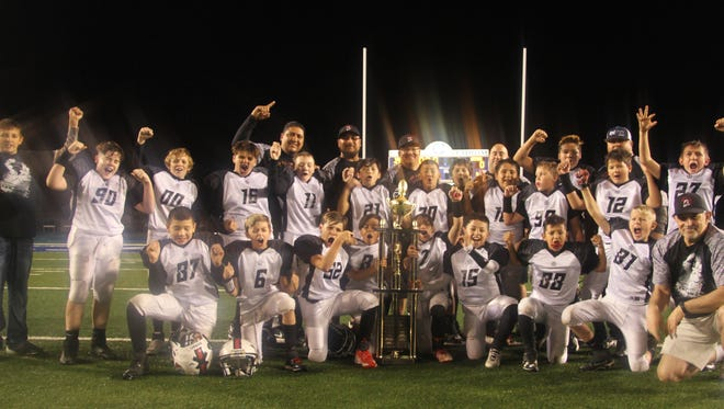 The Trojans in the Little Cavemen Youth Football League were the season champions against the Gators Saturday, Nov. 11, 2017. The team won the game in a 35-0 blowout.