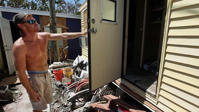 Darren Iorio tries to salvage as much as he can from his home at the Sea Breeze Resort in Islamorada, Florida, after Hurricane Irma brought high winds and flooding to the area destroying most of the homes in the community.