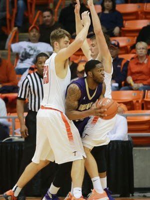 UTEP defenders Hooper Vint, left, and Jake Flaggert surround an  Alcorn State player. The Miners play UTSA on Saturday and Vint has not practiced all week.