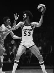 Kentucky Colonel Artis Gilmore handled the ball against a St. Louis Spirits defender.    April 21, 1975