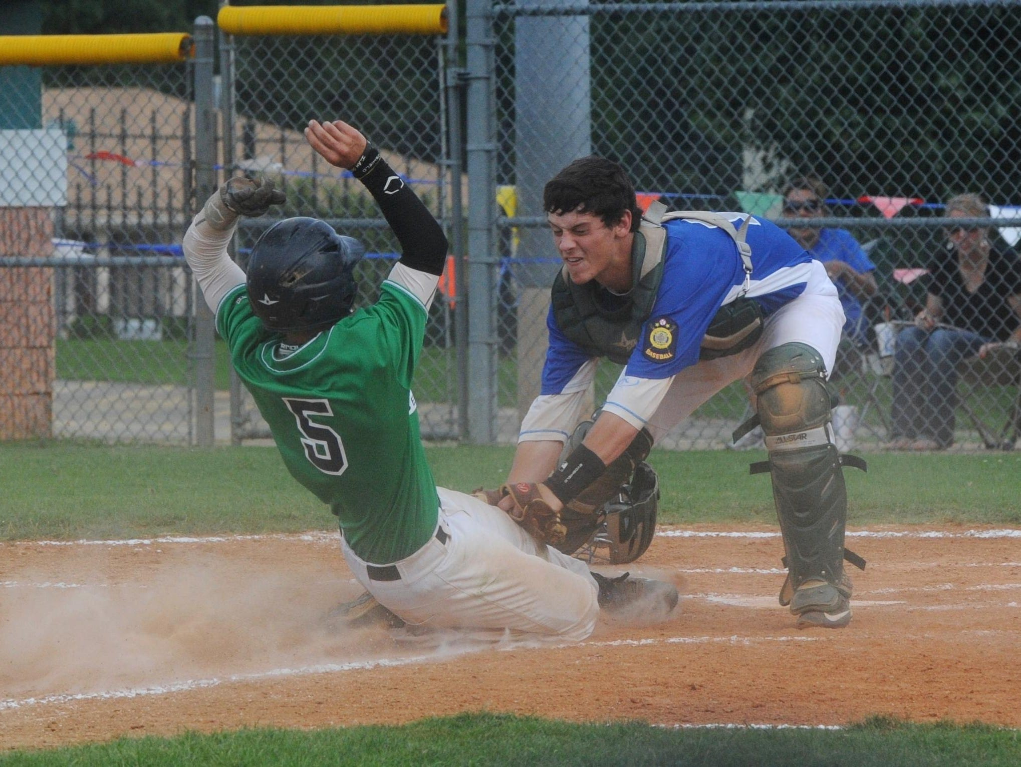 Hopper Environmental Services' Jon Adams (5) is tagged out at home plate by Paragould catcher Andrew Cooper during the Exterminators' 8-4 loss to Glen Sain Ford on Monday night at Cooper Park.