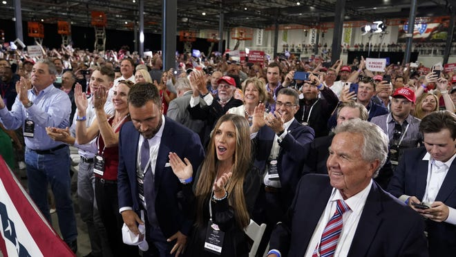 Maskless supporters cheer as President Donald Trump speaks at a rally Sunday in Henderson, Nev.