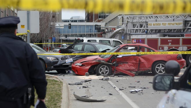 Police investigate a crash at 7th and Cherry streets in downtown Des Moines on Monday, April 2, 2018.