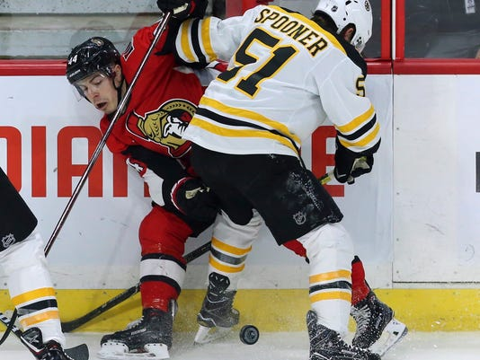 Boston Bruins' Ryan Spooner (51) checks Ottawa Senators' Jean-Gabriel Pageau (44) during the second period of an NHL hockey game Saturday, Dec. 30, 2017, in Ottawa, Ontario. (Fred Chartrand/The Canadian Press via AP)