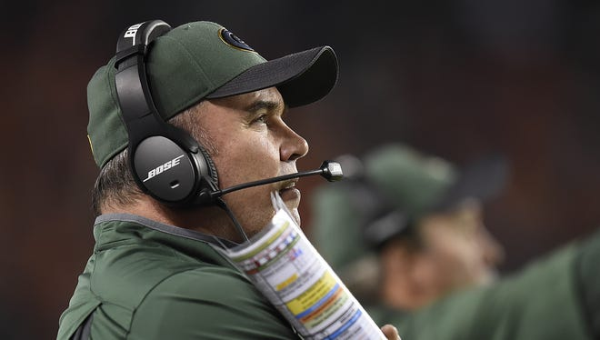Green Bay Packers coach Mike McCarthy looks on during Sunday night's game against the Denver Broncos at Sports Authority Field in Denver.