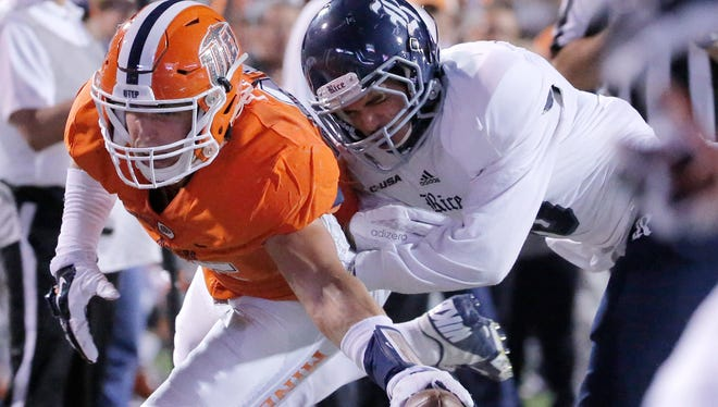 """Rice safety JP Thompson keeps UTEP tight end Hayden Plinke out of the end zone in the first half of their Conference USA game Nov. 6 at Sun Bowl Stadium. Of Saturday's game against North Texas, Plinke says, """"There's no secret formula to football. It's the ultimate team sport and when you play hard, good things happen."""""""