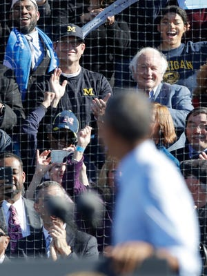 President Barack Obama looks back toward Michigan coach Jim Harbaugh and Democratic U.S. Rep. Sandy Levin, as he campaigns for Democratic presidential candidate Hillary Clinton, Monday in Ann Arbor.