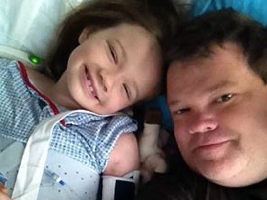 Emily and her father, Todd Ruckle, in a selfie from her hospital bed.
