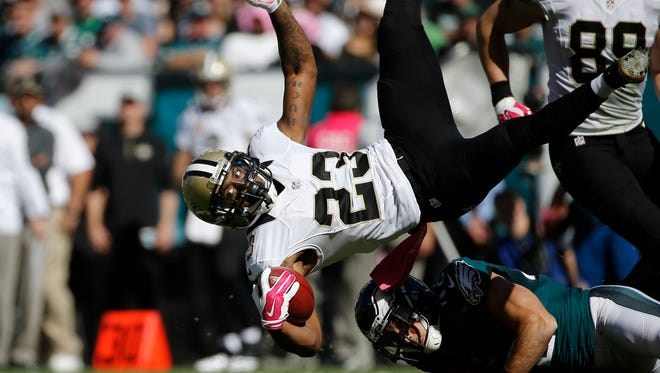 New Orleans Saints' Marcus Murphy is tackled by Philadelphia Eagles' Chris Maragos during the first half of an NFL football game Oct. 11 in Philadelphia.