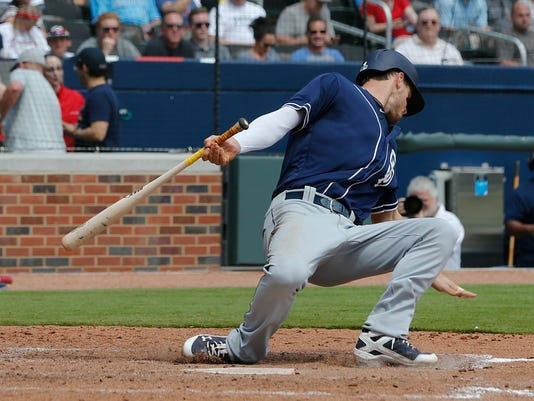 San Diego Padres first baseman Wil Myers (4) falls back from a pitch as he bats in the sixth inning of a baseball game against the Atlanta Braves Sunday, April 16, 2017, in Atlanta. Atlanta won 9-2. (AP Photo/John Bazemore)