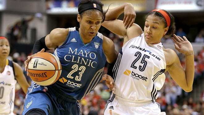 Minnesota Lynx forward Maya Moore (23) drives on Indiana Fever guard Marissa Coleman (25) in the second half of their game. The Indiana Fever play the Minnesota Lynx in Game #3 of the WNBA Finals Friday, October 9, 2015, evening at Bankers Life Fieldhouse.