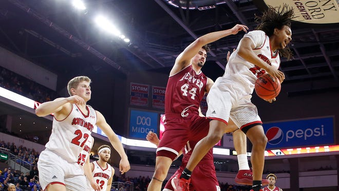 SIOUX FALLS, SD - MARCH 5:  Brandon Armstrong #20 of South Dakota and Austin Sparks #44 of Denver fight for a rebound at the 2018 Summit League Basketball tournament at the Denny Sanford Premier Center in Sioux Falls. (Photo by Dick Carlson/Inertia)