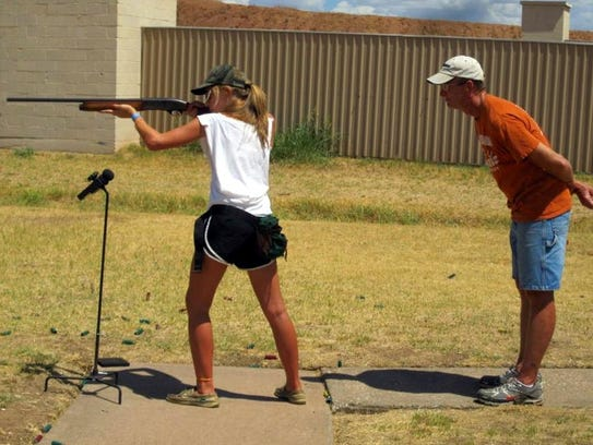 Alison Fields practices shooting under the watchful