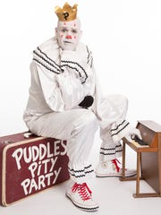 Puddles Pity Party, the 6-foot-7 lounge-singing clown, will perform at 8 p.m. Saturday during the three-day Chalk the Block public arts festival in Downtown.